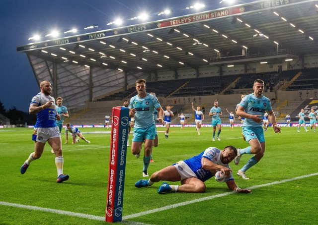 In a hurry: Konrad Hurrell scores the Rhinos' second try against Wakefield Trinity. Picture Bruce Rollinson