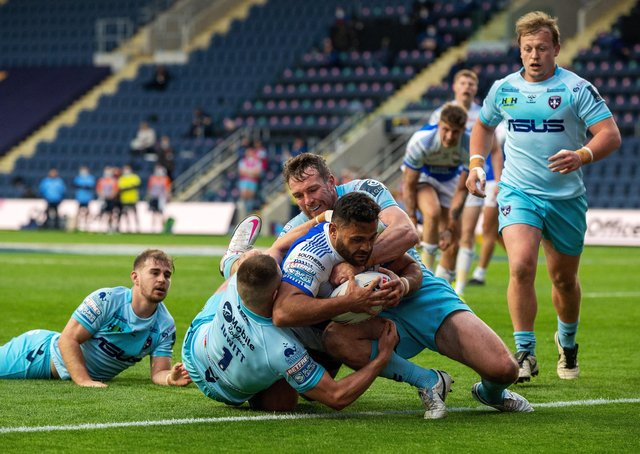 Match winner: Rhyse Martin heads for the line to score the Rhinos first try. He also kicked three goals including the golden point extra-time penalty. Picture Bruce Rollinson