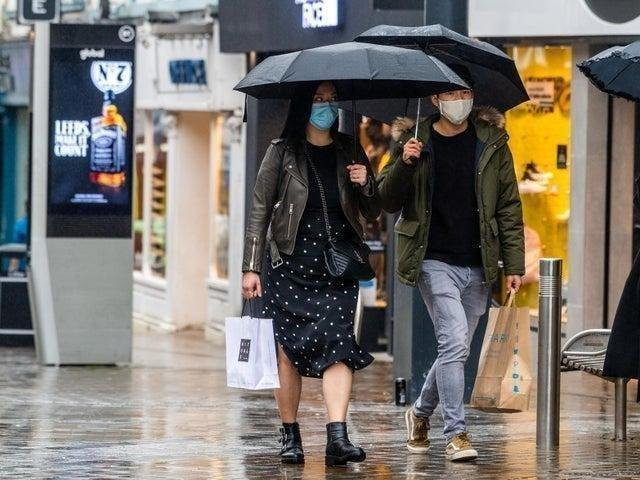 Shoppers in rainy Leeds.