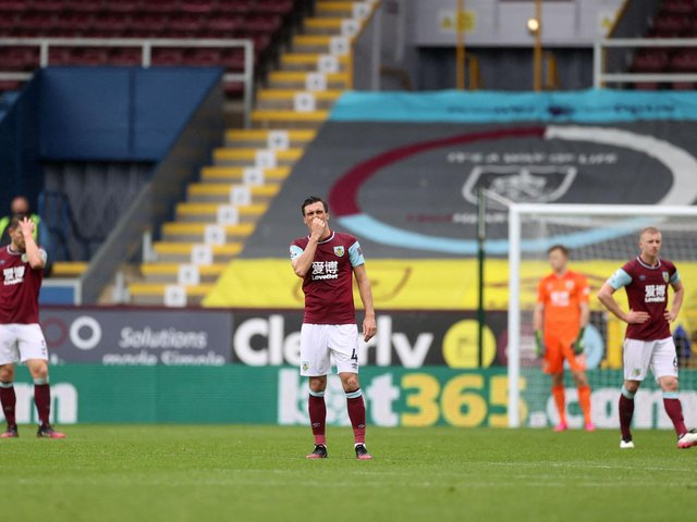 DISAPPOINTMENT: For Burnley and midfielder Jack Cork, centre, in Saturday's 4-0 defeat against Leeds United at Turf Moor. Photo by CARL RECINE/POOL/AFP via Getty Images.