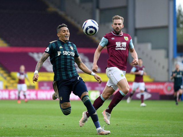 BRAZILIAN BATTLE: Burnley's former Leeds United left back Charlie Taylor, right, locked in combat with Whites winger Raphinha in Saturday's Premier League clash at Turf Moor. Photo by Simon Hulme.