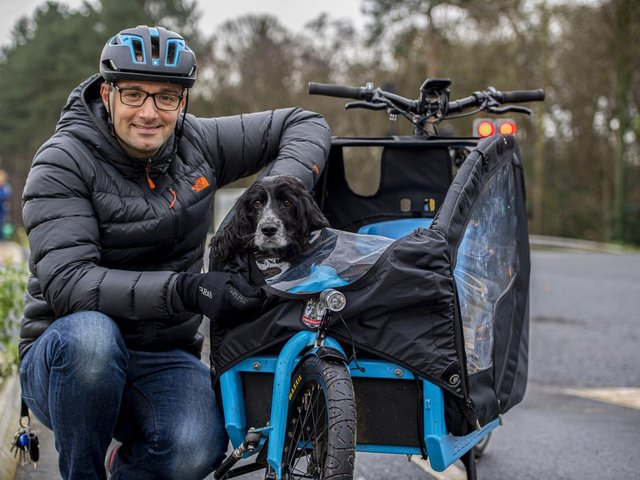 Man and dog in cycle trailer. Photo: Leeds City Council