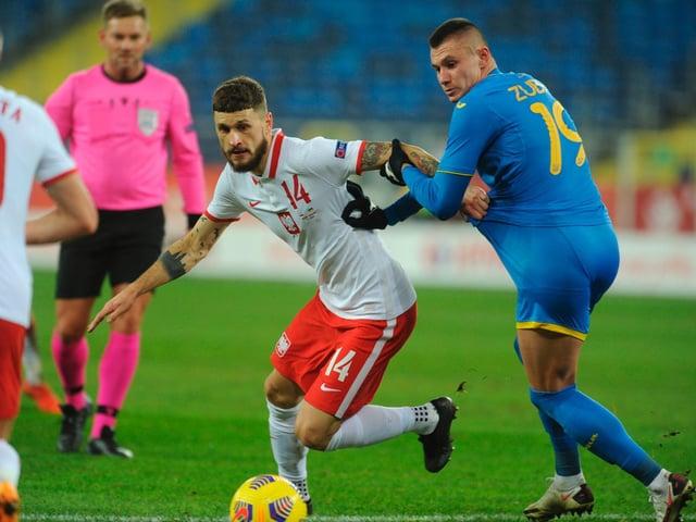 EUROS BOUND: Leeds United's Polish international midfielder Mateusz Klich, centre. Photo by BARTOSZ SIEDLIK/AFP via Getty Images.