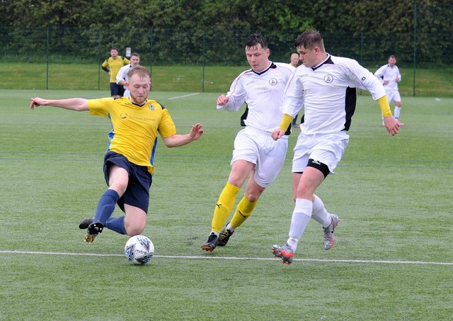 Matthew Jackson, of Gildersome Spurs OB, is first to the ball during Saturday's Yorkshire Amateur Premier defeat to visiting Nostell MW. Picture: Steve Riding.
