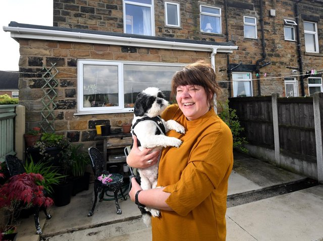 Foster carer Rachel Charlton pictured with her dog Leo at her home at Rothwell.  Photo: Simon Hulme