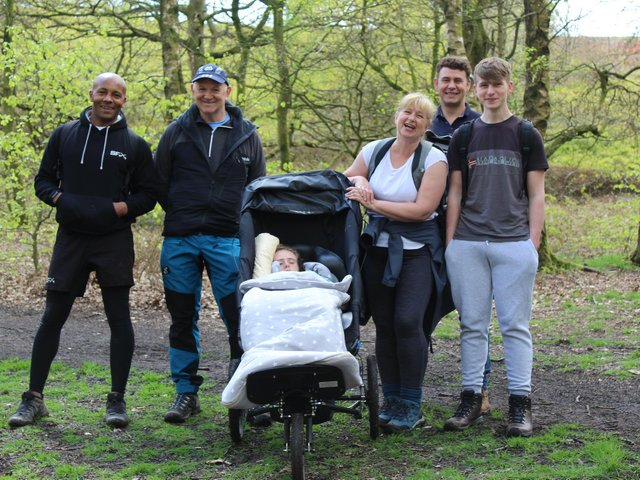 From left: Kingsley Simmons and Phil Lee of Kuta Outdoors with Holly Walker and family members Julie, Lee and Elliot Walker.