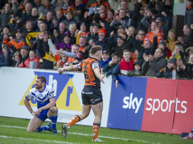 Jake Trueman celebrates with Tigers' fans after scoring against St Helens at the Jungle last year. Picture by Tony Johnson.