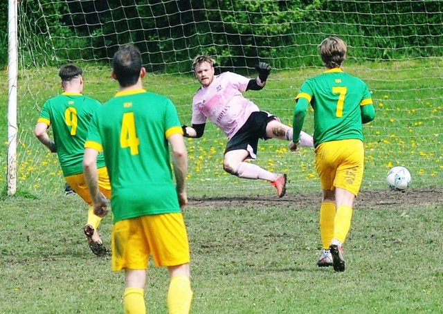 Mark Ferguson scores for Main Line Social in the Leeds Combination League Jubilee Premier clash with HT Sports. Picture: Steve Riding.