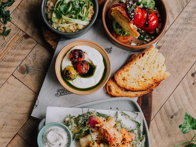 Multiple dishes served as one on a board at The Botanist