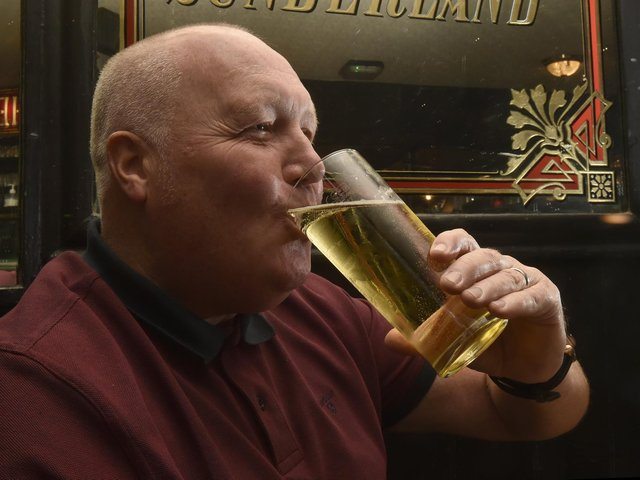 Martin Womersley enjoys his first pint inside a pub since lockdown at Whitelocks, Leeds (photo: Steve Riding)
