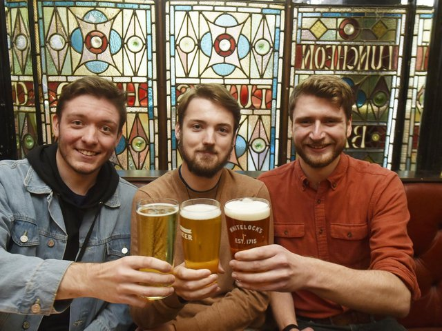 Friends who met at Uni enjoy a reunion pint at Whitelocks, Leeds, Luke Neild, Jack Kirk and Thomas Walker cc Steve Riding/JPI
