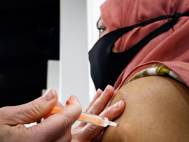A woman received her jab at the Elland Road vaccine centre in Leeds. Picture: Danny Lawson/PA