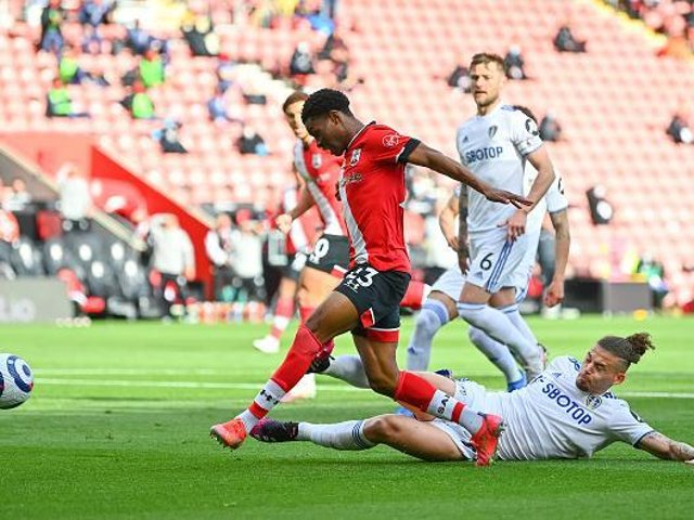 ON THE SCENE: Leeds United's England international midfielder Kalvin Phillips looks to tackle Southampton's lively Nathan Tella. Photo by Dan Mullan/Getty Images.