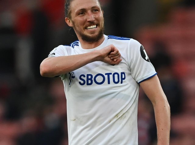 LOVING IT: Luke Ayling dishes out the Leeds salute at St Mary's. Photo by Neil Hall - Pool/Getty Images.