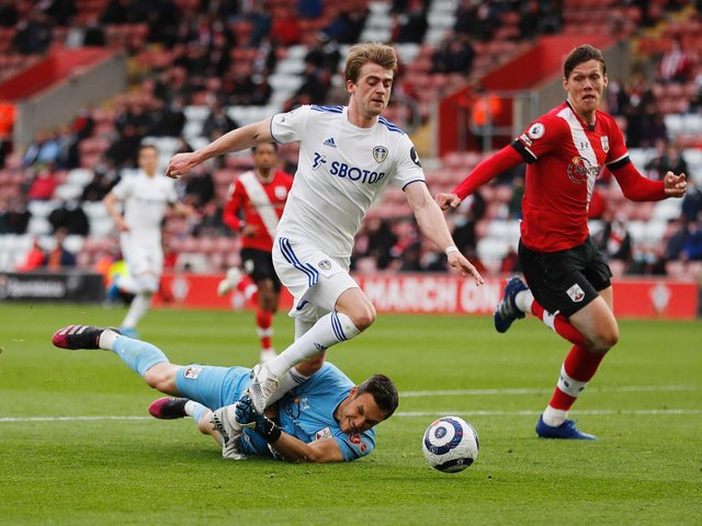 NOT GIVEN: Southampton 'keeper Alex McCarthy makes clear contact with Patrick Bamford and knocks the striker off balance but no penalty was awarded as Bamford stayed on his feet. Photo by Frank Augstein - Pool/Getty Images.