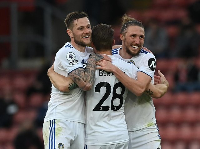 Leeds United's Liam Cooper, Luke Ayling and Gaetano Berardi embrace at full-time. Pic: Getty