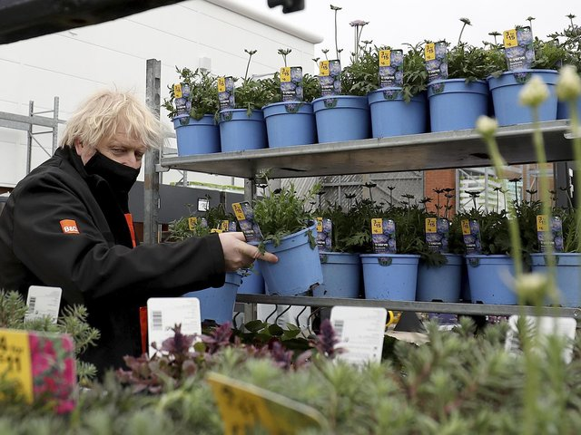 Prime Minister Boris Johnson chooses a plant as he visits the garden centre in the B&Q store in Middlesbrough.