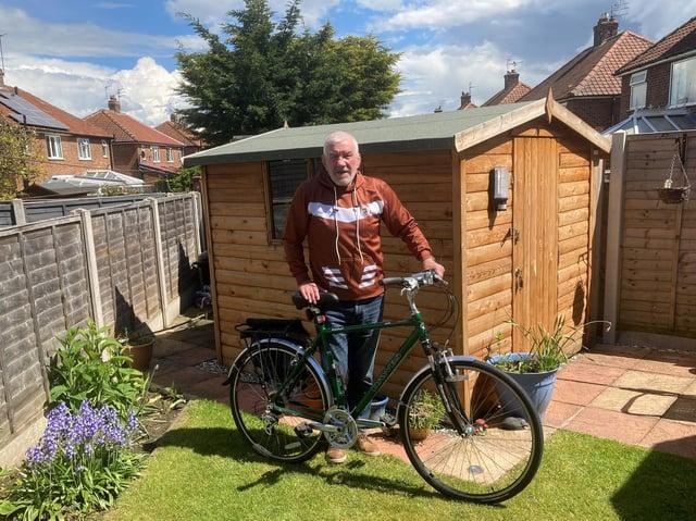 Ken Sykes prepares for his fund-raising ride.
