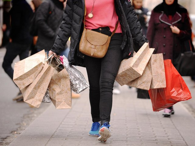 Library image of a woman carrying shopping