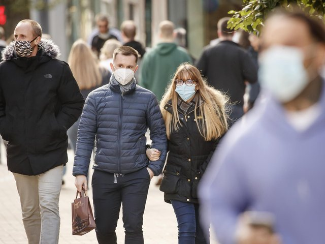 People wearing face coverings in Leeds.