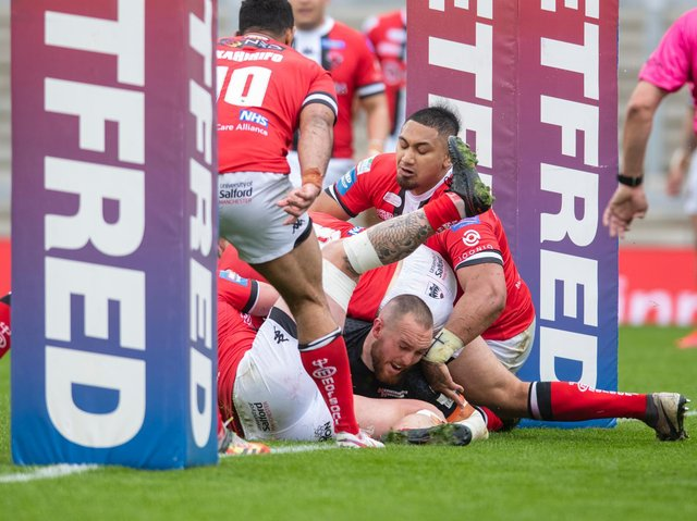 Daniel Smith scores for Tigers in their Challenge Cup quarter-final win over Salford. Picture by Tony Johnson.