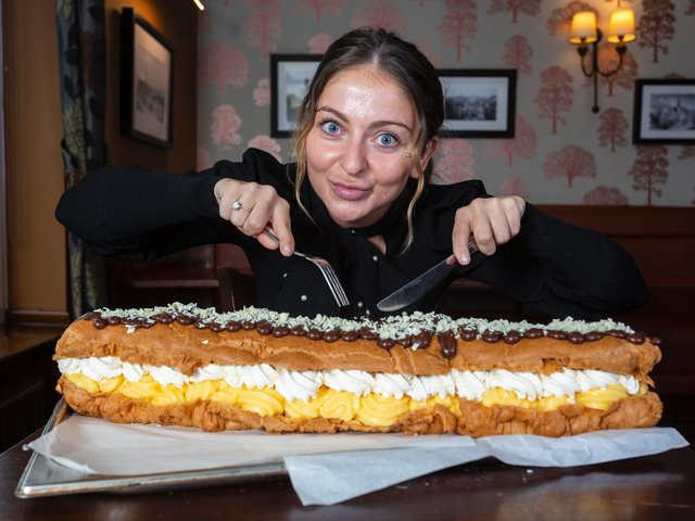 Jamie Wilson, 27, has challenged dessert lovers to try to tame the 'eclair to end all eclairs' - but said the dessert would scare even the most sweet toothed among us. cc SWNS