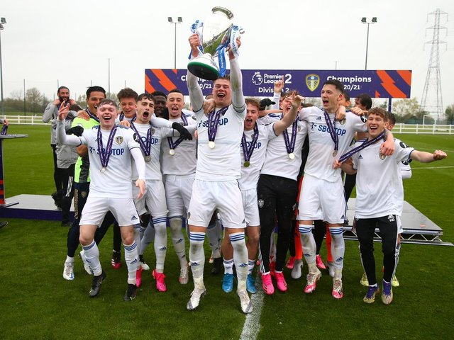THE FUTURE: Captain Charlie Cresswell and the rest of the Leeds United under-23s team celebrate getting their hands on the Premier League 2 Division Two title winners' trophy. Picture by LUFC.