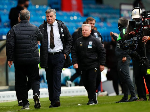DISAPPOINTED: Outgoing West Brom boss Sam Allardyce, centre, interacts with Leeds United head coach Marcelo Bielsa, left, after Sunday's 3-1 defeat at Elland Road. Photo by Lynne Cameron - Pool/Getty Images.
