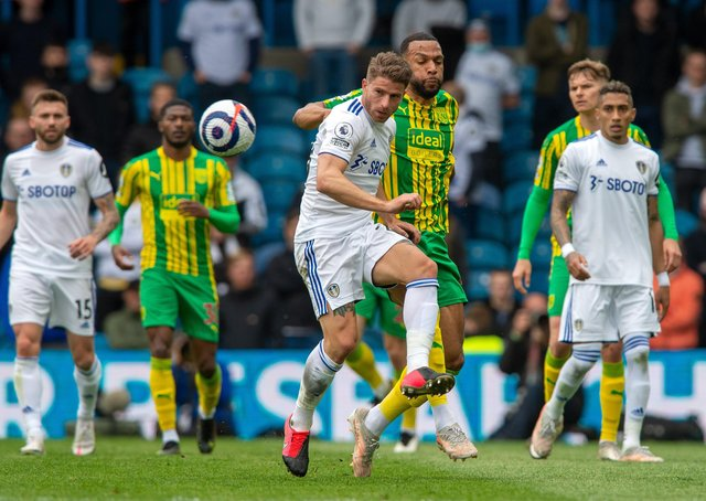 Gaetano Berardi clears from Kyle Bartley. Picture: Bruce Rollinson.