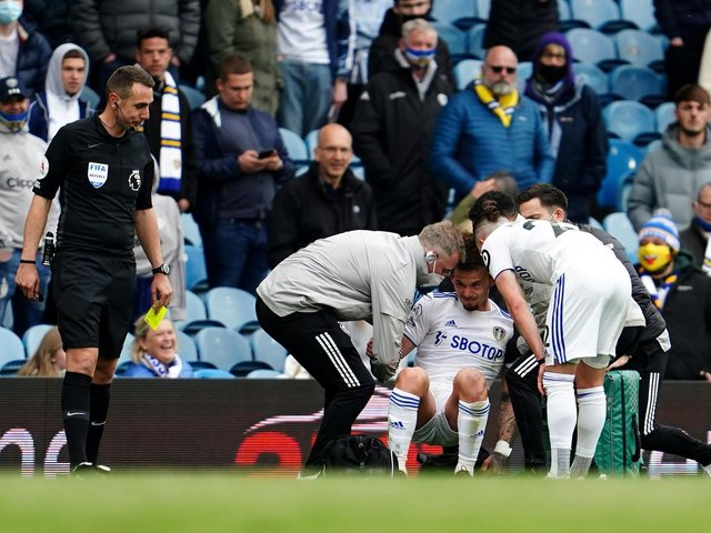 CONCERN: Leeds United's England international midfielder Kalvin Phillips receives treatment in the closing stages of Sunday's 3-1 victory against West Brom at Elland Road. Photo by Jon Super - Pool/Getty Images.