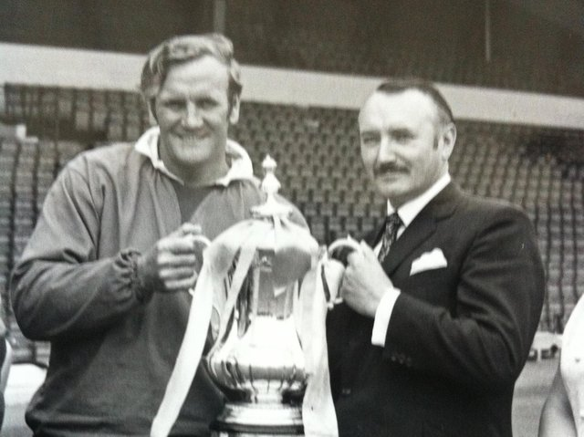 Geoff Williams with Leeds United manager Don Revie holding the FA Cup