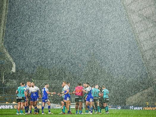 Torrential rain struck at the end of Sunday's game. Picture by Alex Whitehead/SWpix.
