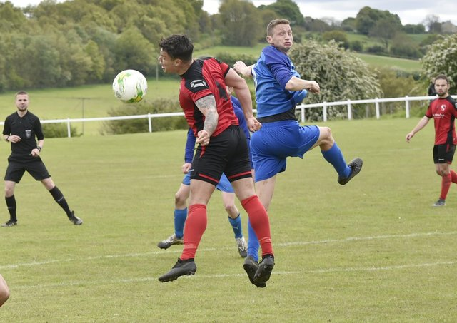 Ash Atkinson, right of Boroughbridge, heads on past Horbury Town defender James Smith during Saturday's Premier encounter. Picture: Steve Riding.