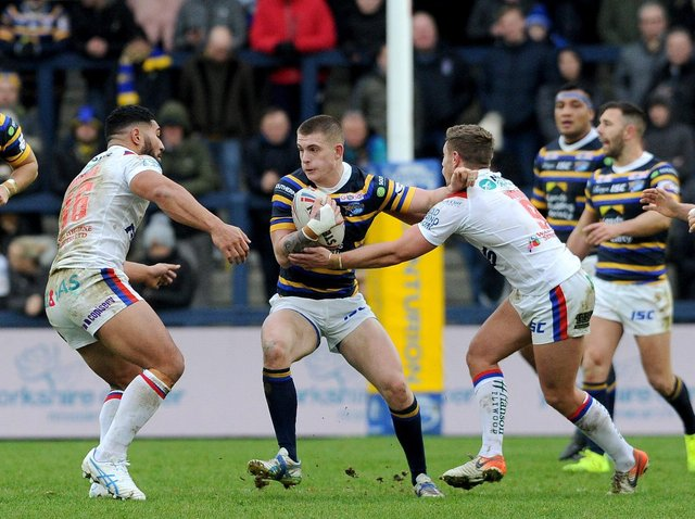 Corey Johnson, with ball, featured for Rhinos in their 2019 Boxing Day clash with Wakefield Trinity. Picture by Steve Riding.