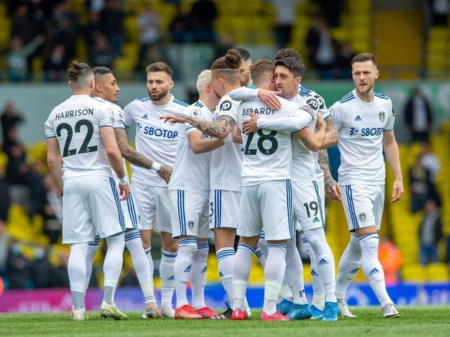 Leeds United embrace at Elland Road on the final day of the season.