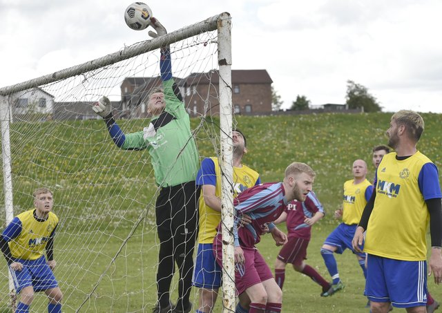 Stanningley OB Res goalkeeper Brad Longthorpe tips the ball over for a corner in the 2-0 defeat to Norristhorpe Rangers who hold a nine-point lead at the top of the Division 3 table. Picture: Steve Riding.