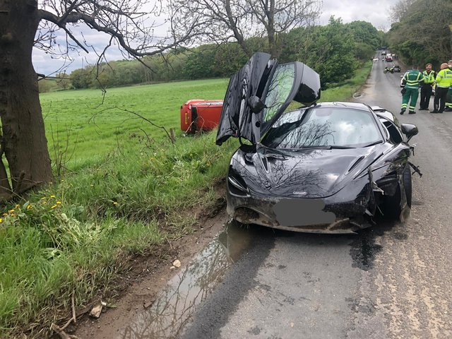 The driver of the black McLaren 720S Spider tried to overtake another car in Huddersfield. Photo: West Yorkshire Police.