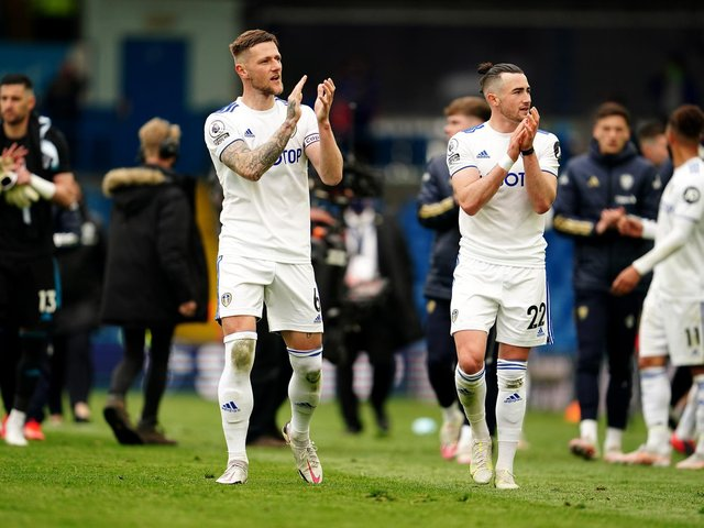 WHAT A YEAR: Club captain Liam Cooper, left, and Jack Harrison, right, applaud Leeds United's fans following Sunday's season finale victory against West Brom at Elland Road. Photo by Jon Super - Pool/Getty Images.