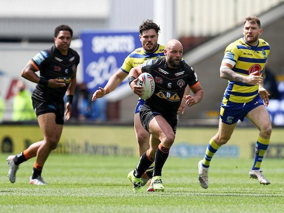 Paul McShane on the attack for Tigers at Warrington last weekend. Picture by Paul Currie/SWpix.com.