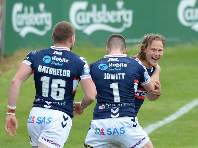 Wakefield Trinity captain Jacob Miller celebrates his try on his return from injury against Hull KR. (DEAN WILLIAMS)
