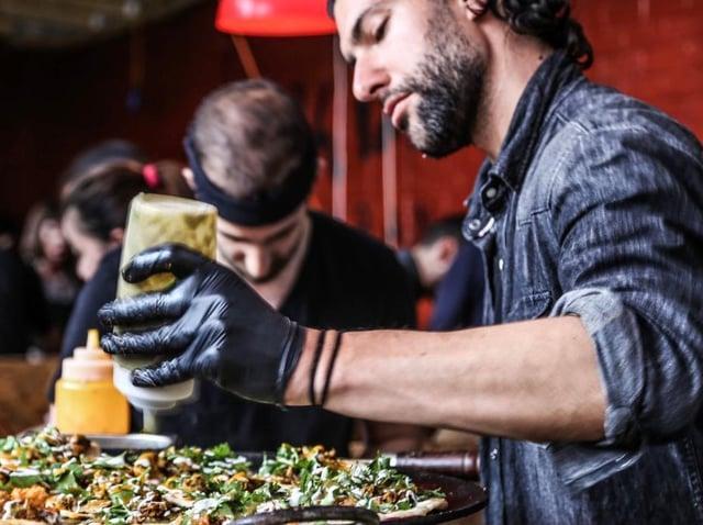Mark White, the founder of Leeds street food eatery Rola Wala