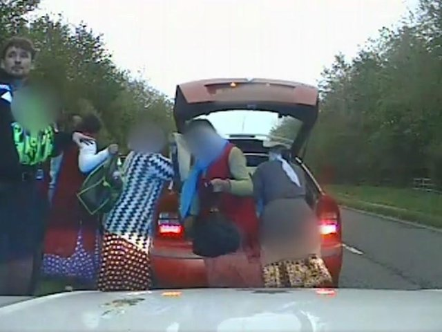 Police dashcam footage of the moment nine people emerge from a car pulled over in North Yorkshire