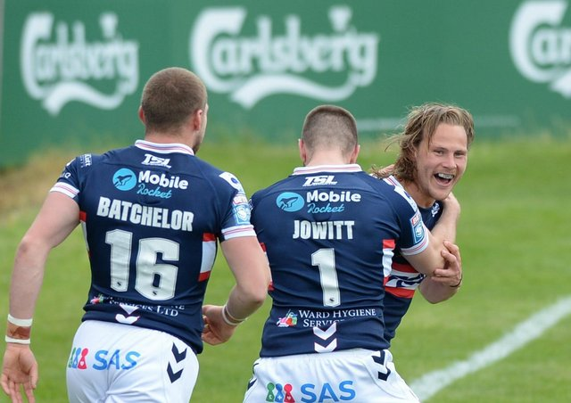 BACK ON TRACK: Wakefield Trinity's Jacob Miller celebrates his try with Max Jowitt and James Batchelor during the win over Hull KR. Picture courtesy of Dean Williams