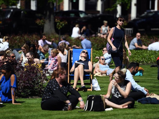 Stock image - people enjoy the sun in Park Square in Leeds (photo: Jonathan Gawthorpe)