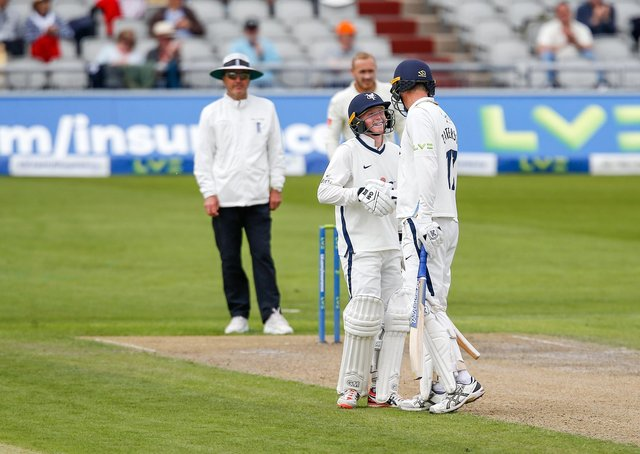 Well done: Harry Duke, left, is congratulated on his Roses half-century by Yorkshire captain Steve Patterson. Picture: John Heald