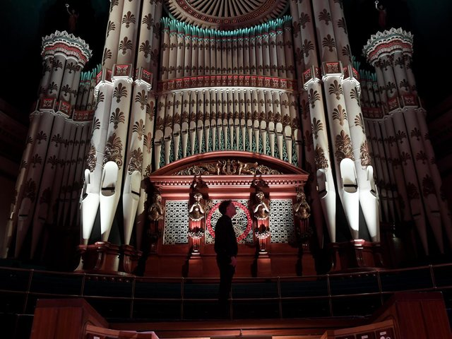 Leeds City Organist Darius Battiwalla pictured with the organ at Leeds Town Hall. Picture: Simon Hulme.