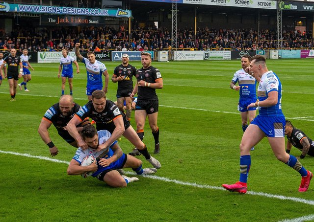 First of many: Tom Briscoe scores the Rhinos' first try.  Picture Bruce Rollinson