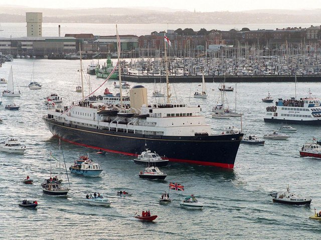 The Royal Yacht Britannia sailing into Portsmouth for the last time before being decommissioned in 1997.