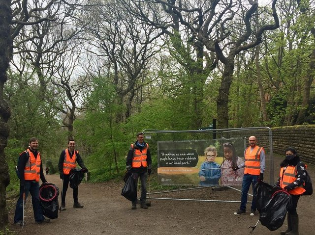 Members of the council's sustainable energy and air quality teams undertake a litter pick at Woodhouse Ridge