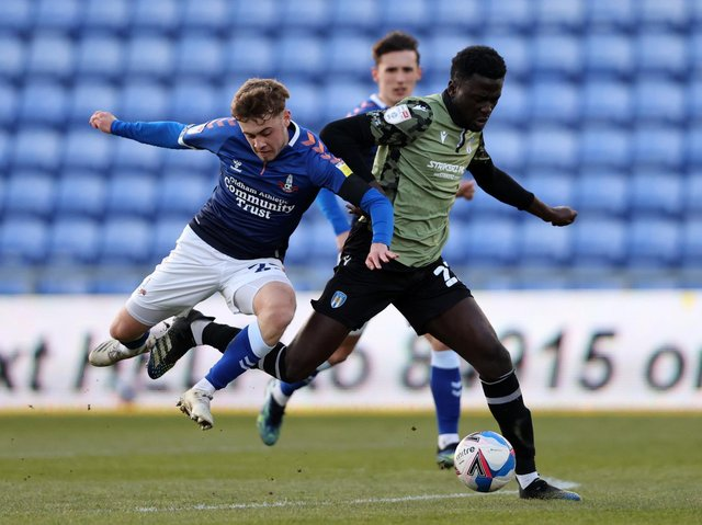 Leeds United loanee Alfie McCalmont (L) in action against Colchester. Pic: Getty